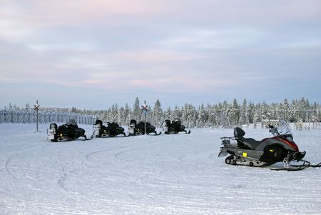 Parking of snowmobiles, finland, lapland Stock Photo - 6298341