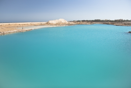 Amazing Blue lake among the sand and rocks photo