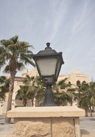 Retro street lamp near the beach at summer day photo