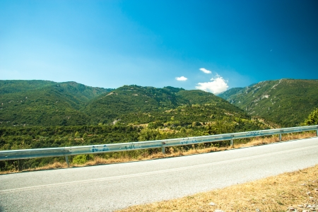 Road in mountain range at Olympos Mountains photo