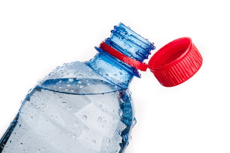 Plastic bottle of drinking water isolated on white photo
