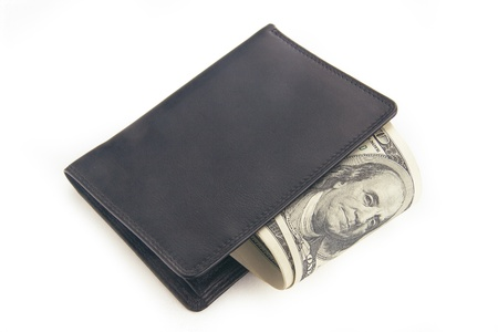 US dollars in a black wallet isolated on white photo
