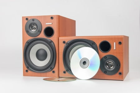 surround system: wooden sound speakers with a disc isolated on white background Stock Photo