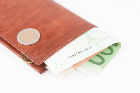 one hundred euro banknote: Brown wallet with EU money and a coin Stock Photo