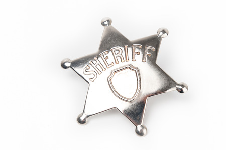 Sheriff's badge isolated on white  photo