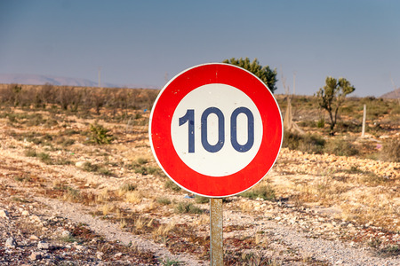 traffic violation: Speed limit sign 100 km per hour at the road Stock Photo