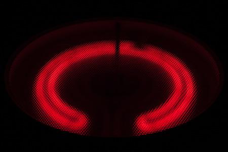 Ceramic Stove Top - hot spiral on black photo