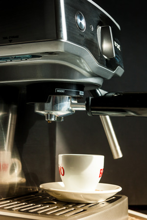 with coffee maker: Stainless Steel Coffee maker machine Close Up