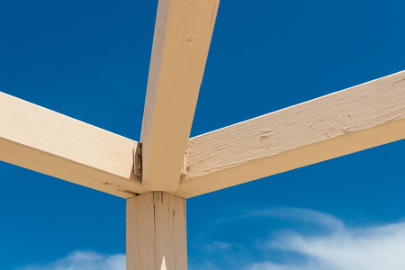 wooden beams: Solid Wooden beams against the blue sky Stock Photo