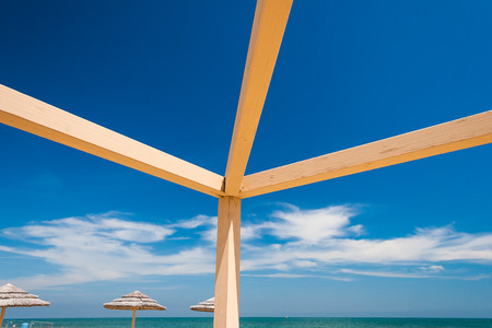 solid: Solid Wooden beams against the blue sky Stock Photo