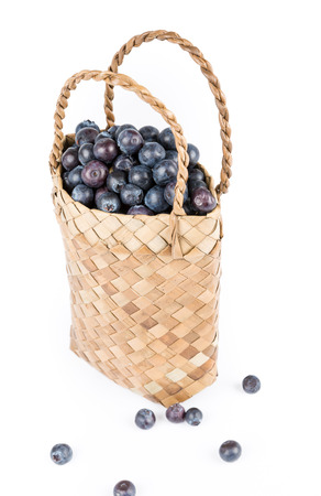 willow fruit basket: Wicker basket with Blueberries Isolate on white background Stock Photo