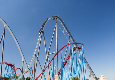 theme: Roller Coaster in Amusement Entartainment Theme Park at summer time