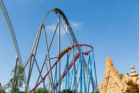 Roller Coaster in Amusement Entartainment Theme Park at summer time