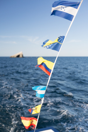fluttering: Some national flags fluttering on the rope on deck