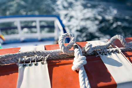 protective eyewear: Red and White Safety equipment on the sail boat Stock Photo