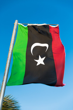 mideast: Waving National flag of Libya on flagpole Stock Photo