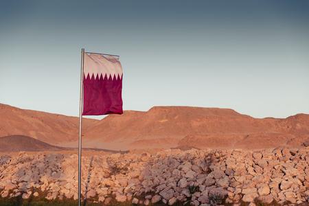 mideast: Waving National flag of Qatar on flagpole