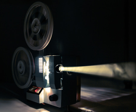 film projector: Running Old film projector in dark room Stock Photo
