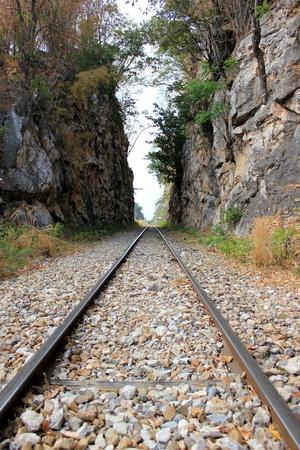 Channel railway through the mountains in Kanchanaburi (Thailand). Stock Photo - 13367049