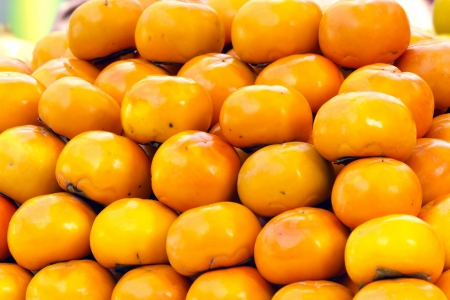 Persimmons for sale at the market. photo