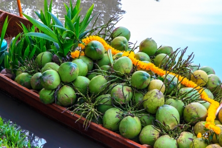 coconut on row boat is sell for people.