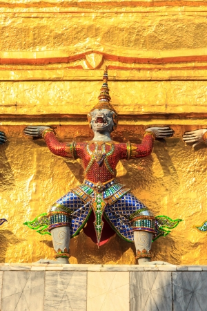Statue sholdering chedi gold in wat phra kaew. Stock Photo - 17177373