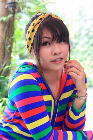 Thai girl is dental braces and cute in bright colors