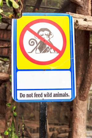 Sign do not feed wild animals  old in the zoo Stock Photo