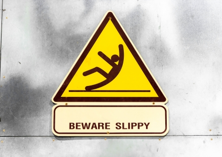 cantonese: Sign  beware slippy on wall in toilet