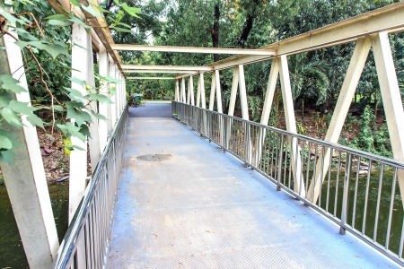 Bridge made buy steel for people cross to garden. Stock Photo - 20219915