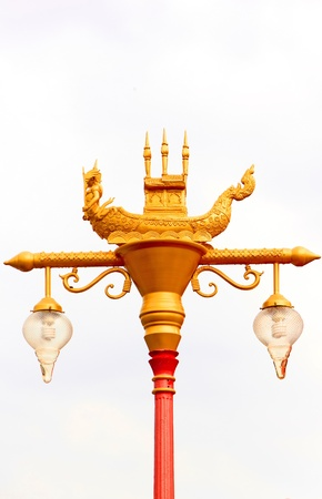 Lamp pole art of thai style have gold colur and red photo