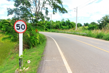 Sign on way cuve is drive car speed not overload 50 km