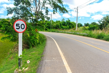 cuve: Sign on cuve way is not overload speed 50 km. Stock Photo