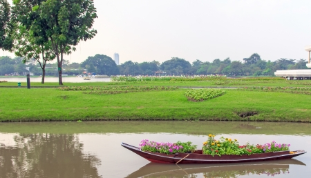 Row boat on garden and flower on baot