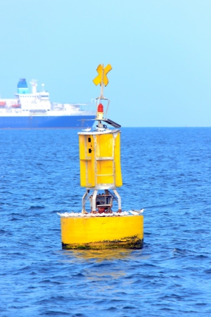 laurence: buoy yellow on sea for is signal on afternoon and night time.