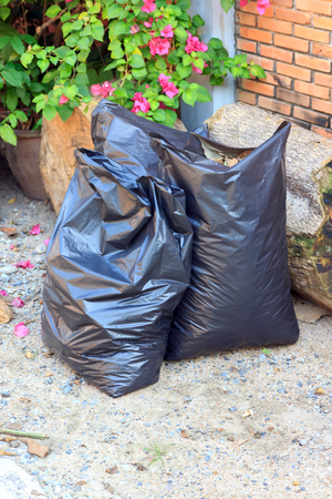 eliminate: garbage bags  black on out door it wait for eliminate Stock Photo