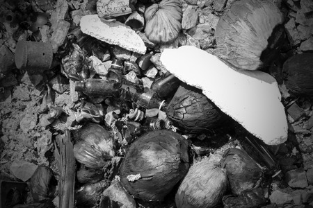 garbage  on sea it have glass , canned and   coconut process iblack white Stock Photo