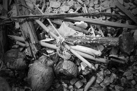 garbage  on sea it have glass , canned and   coconut process black and white