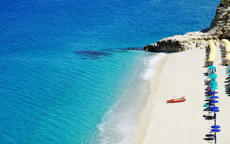 azure water and white sand in Tropea Calabria at the beach