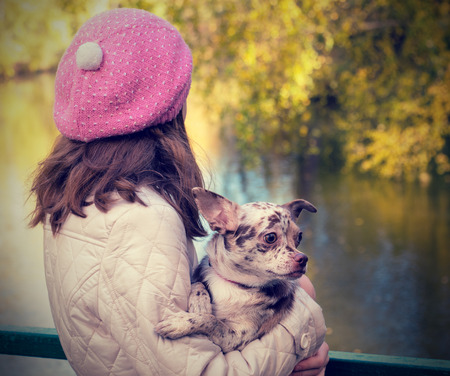 Girl with a dog outdoors photo