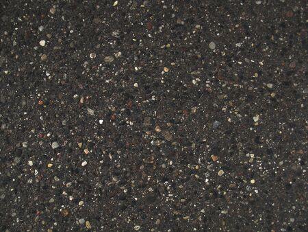 Asphalt texture design. Roadway close up photo. Grey road backdrop.