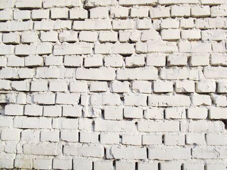 Weiße Backsteinmauer. Grunge-Textur. Vintage Mauerwerk Standard-Bild