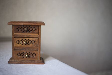 Wooden jewelry box with ornament. Container for precious