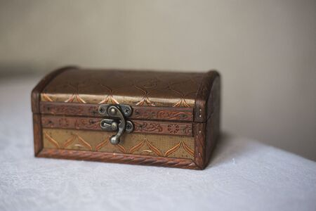 Wooden jewelry box with vintage lock. Container for decoration