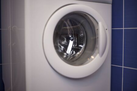 Washing machine door. Household equipment for cleaning. Modern housework appliance.