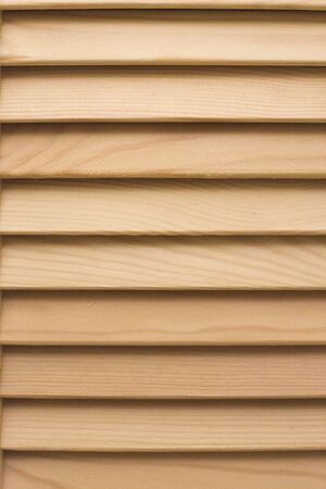 Wooden blinds panel. Striped timber texture. Vintage home design.