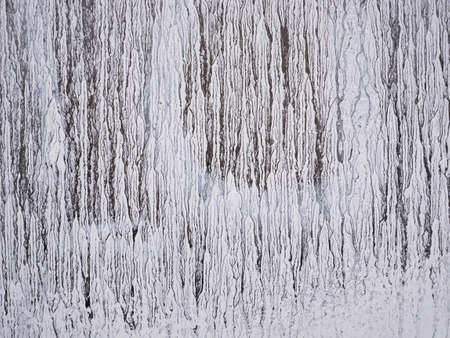 Dry white strokes paint dripping on glass. Old grunge texture. Opaque stained window