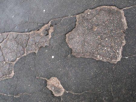 Cracked asphalt surface texture. Road or sidewalk pothole, broken pavement 写真素材 - 150603637