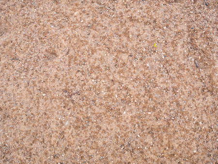 Decorative sand wallpaper. Stones texture decoration. Grain background. Banco de Imagens