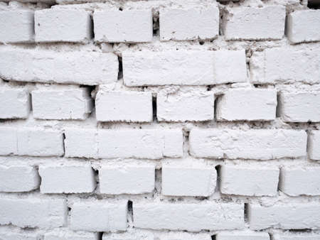 White brick wall background design. Building surface texture. Old cracked construction, stone wallpaper.